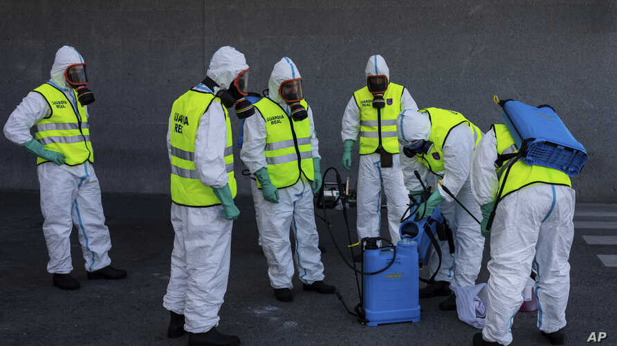 Spanish Royal guard soldiers disinfect a hospital to prevent the spread of the new coronavirus in Madrid, Spain, Sunday, March…