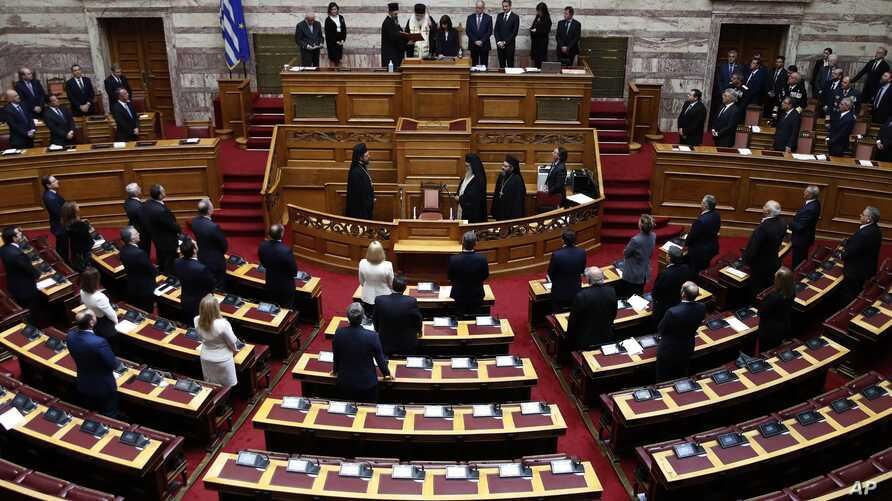 Newly elected Greek President Katerina Sakellaropoulou takes an oath during the swearing in ceremony at the Greek Parliament in…