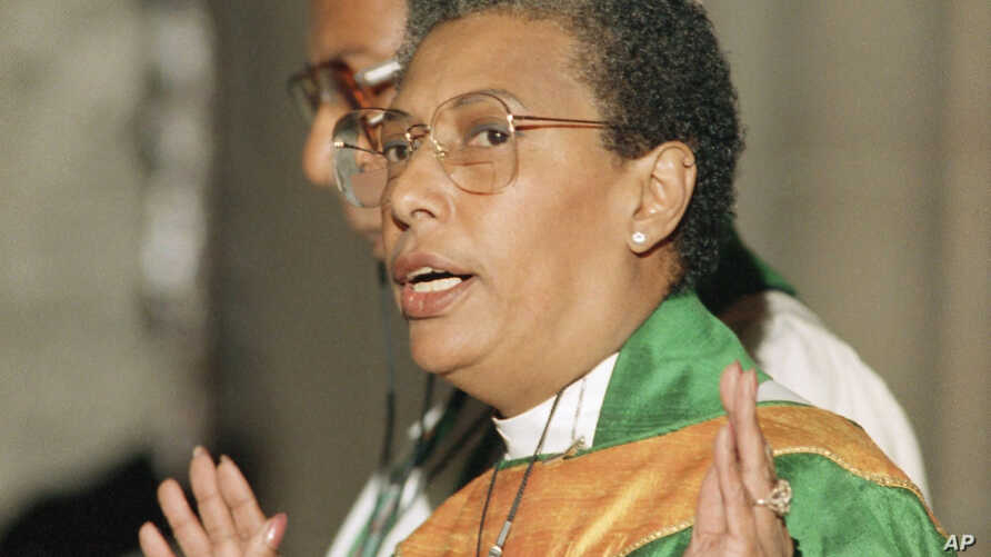 Rev. Barbara C. Harris gestures in her north Philadelphia church during her first service, Sept. 25, 1988 since being elected…