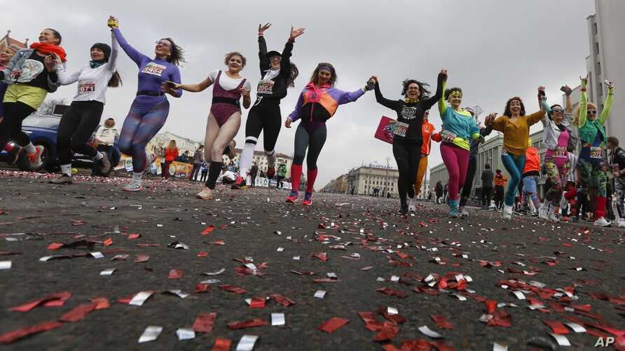 Participants take part in the women's 'Beauty Run' in Minsk, Belarus, Sunday, March 8, 2020. Five thousands participants took…