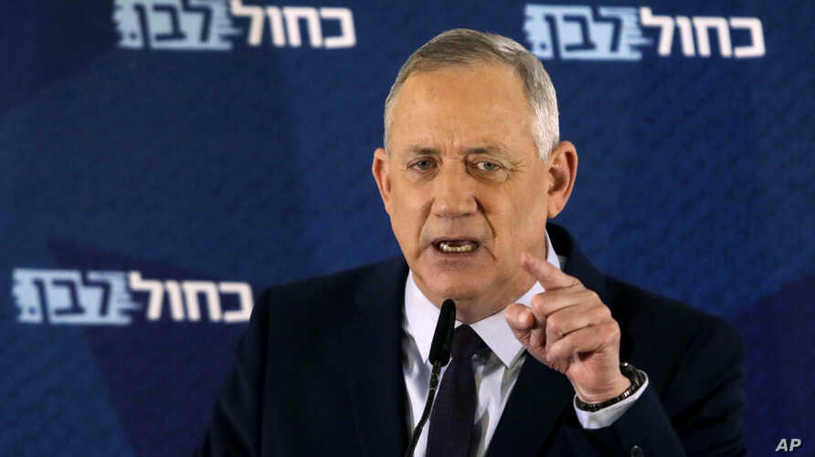 FILE - In this Saturday, March 7, 2020 file photo, Blue and White party leader Benny Gantz delivers a statement in Tel Aviv,…