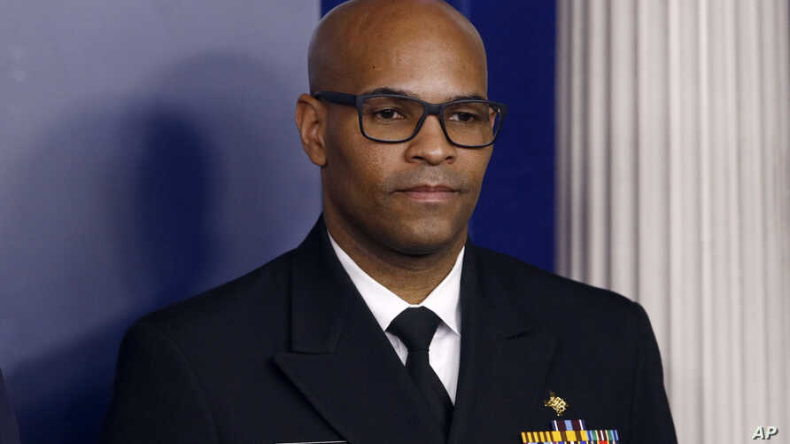FILE - In this March 22, 2020, file photo U.S. Surgeon General Jerome Adams attends a coronavirus task force briefing at the…