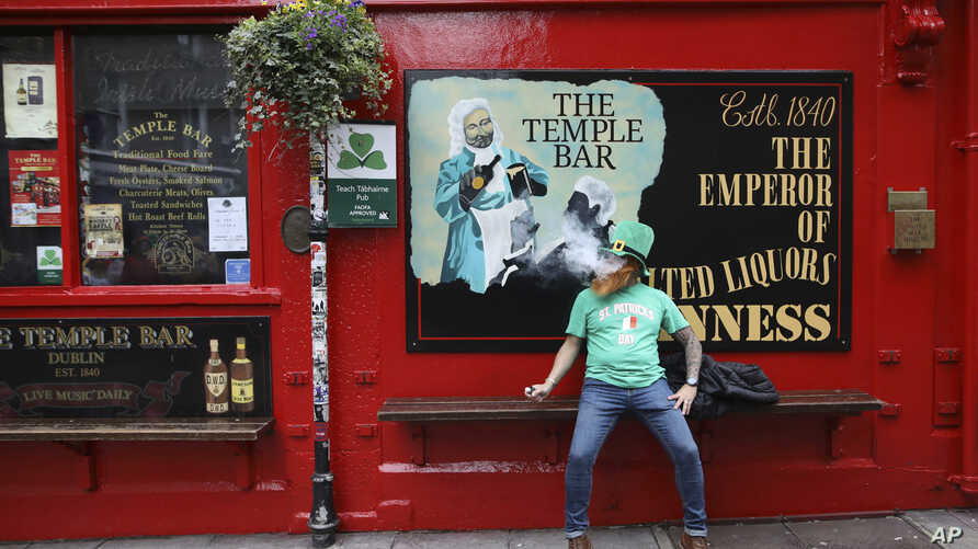 A man dressed up for St Patricks Day outside Temple Bar in Dublin city centre, Tuesday March 17, 2020. The St Patrick's Day…