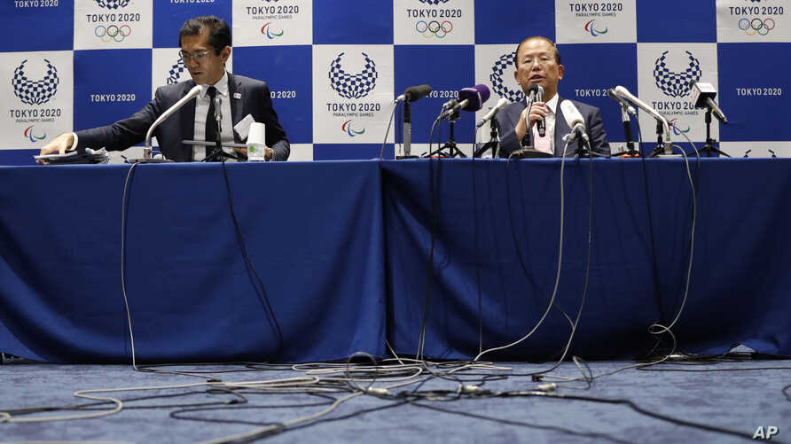 Tokyo 2020 Organizing Committee CEO Toshiro Muto, right, speaks during a news conference after a Tokyo 2020 Executive Board…