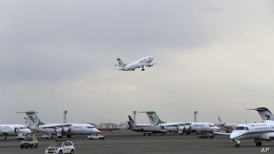 In this photo taken on Feb. 7, 2016, A Mahan Air passenger plane takes off from Mehrabad Airport in Tehran, Iran. Boeing Co…