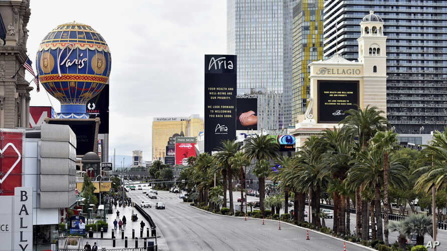 Las Vegas Boulevard is nearly empty after all casinos in the state were ordered to shut down due to the coronavirus Wednesday,…