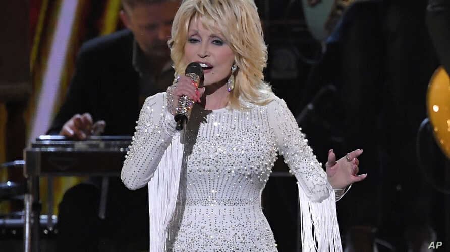 FILE - This Nov. 13, 2019 file photo shows Dolly Parton performing at the 53rd annual CMA Awards in Nashville, Tenn. Parton…