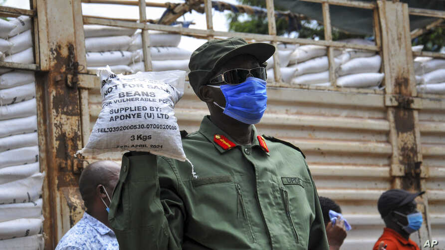 FILE - In this April 4, 2020, file photo, a member of the country's armed forces, the Uganda People's Defence Force (UPDF),…