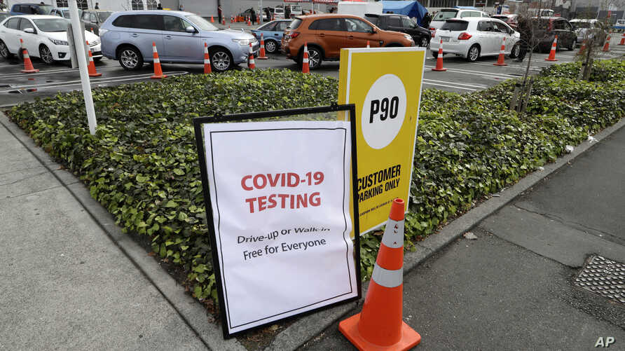 Cars line up at a pop-up community COVID-19 testing station at a supermarket carpark in Christchurch, New Zealand, Friday,…