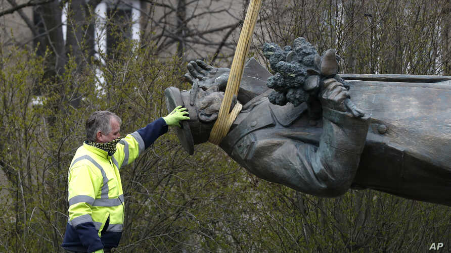 The statue of a Soviet World War II commander Marshall Ivan Stepanovic Konev is loaded onto a truck after its been removed from…