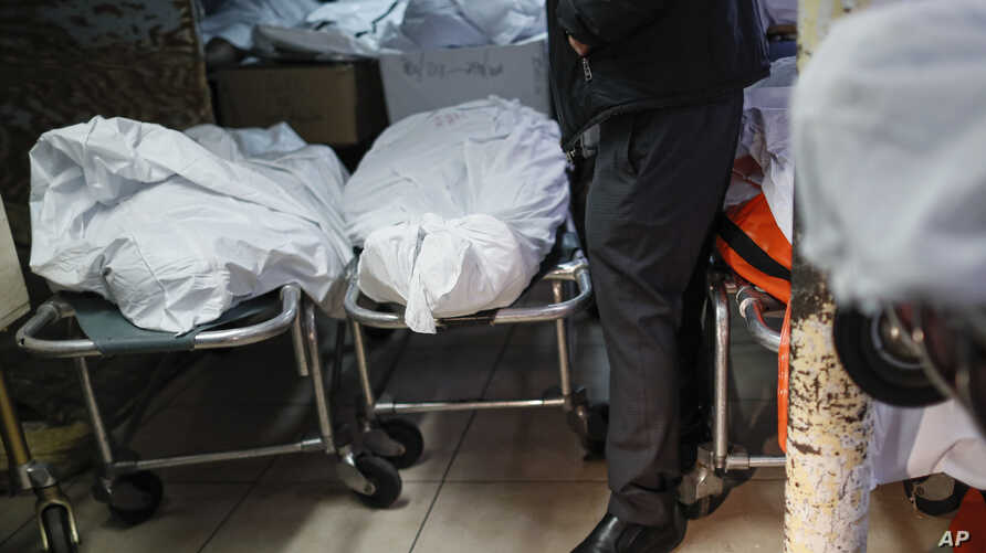 Pat Marmo, owner of Daniel J. Schaefer Funeral Home, walks through his body holding facility that is struggling to handle…