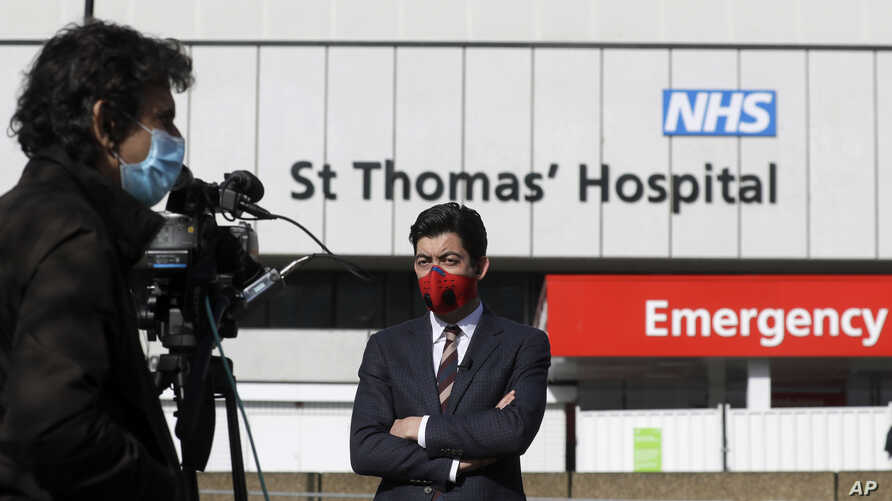 Journalists work outside St Thomas' Hospital in central London as British Prime Minister Boris Johnson was moved to intensive…