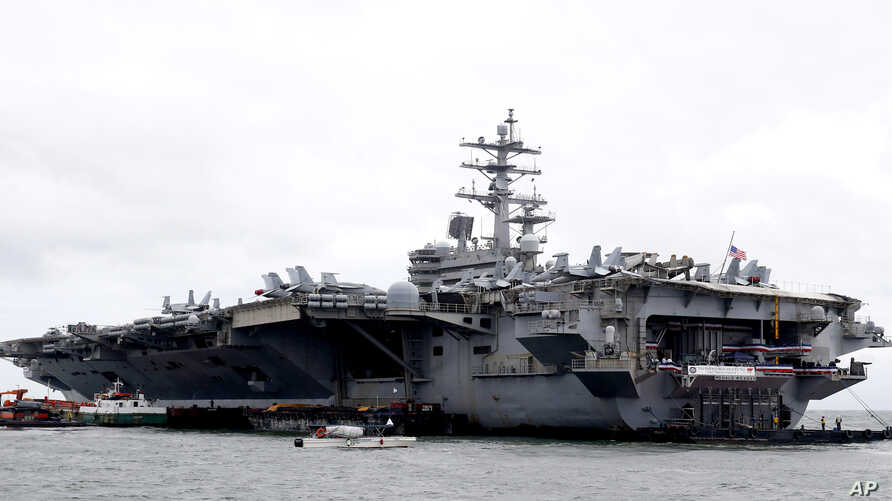 The U.S. aircraft carrier USS Ronald Reagan is anchored off Manila Bay, Philippine, for a port call Wednesday, Aug. 7, 2019…