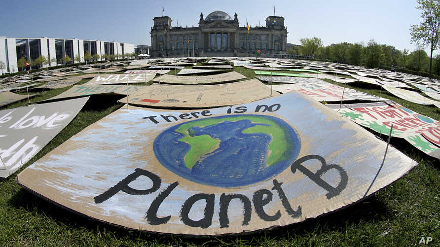 Activists place thousands of protest placards in front of the Reichstag building, home of the german federal parliament,…