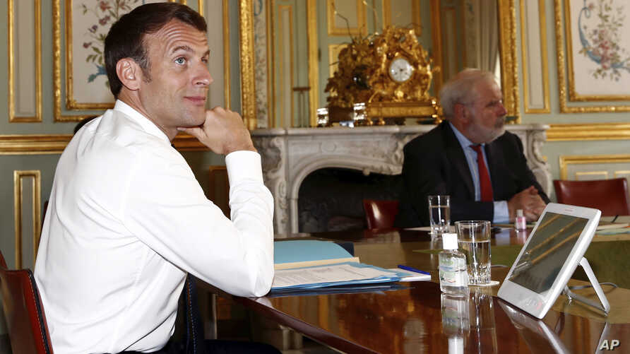French President Emmanuel Macron reacts during a videoconference on the conoravirus with Group of Seven leaders at the Elysee…