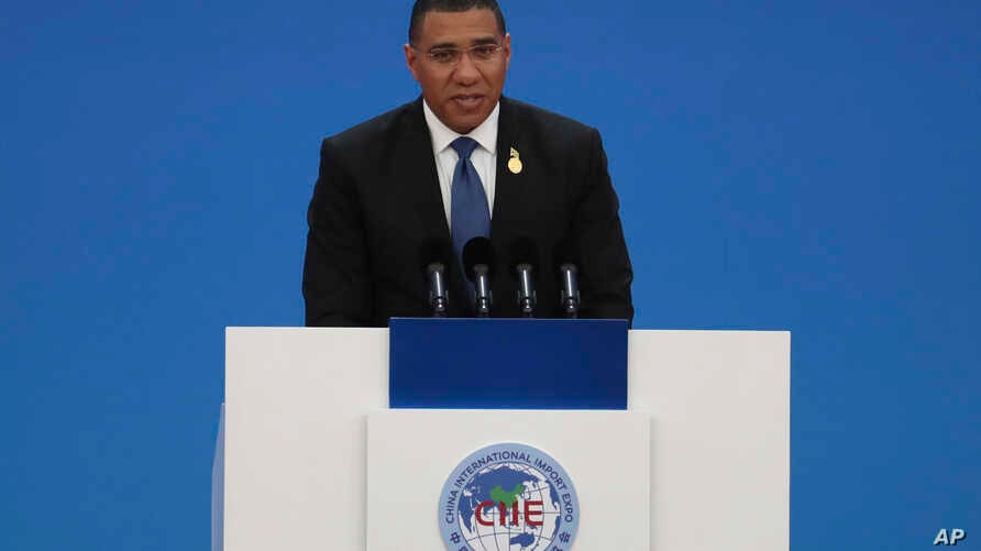 Jamaica's Prime Minister Andrew Holness delivers a speech at the opening ceremony of the China International Import Expo in…