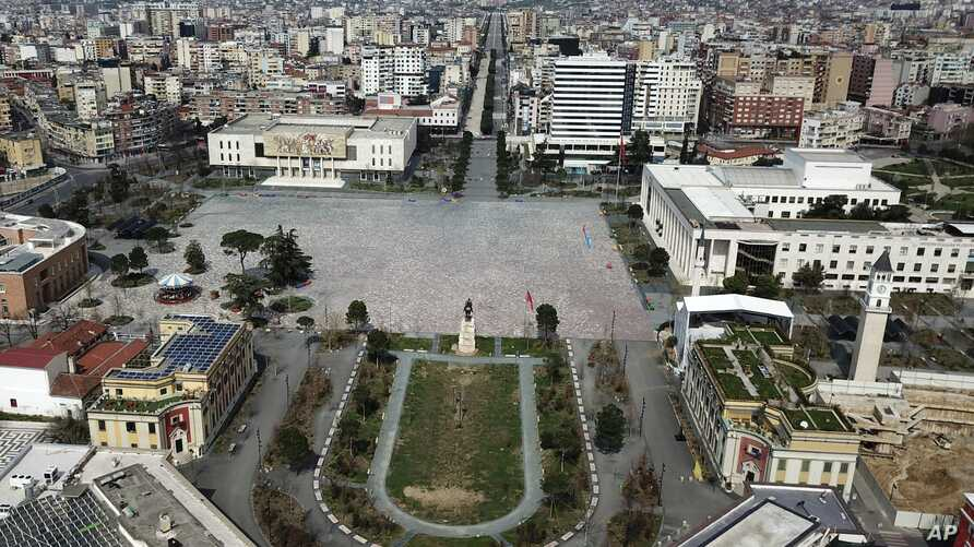 The empty Tirana's main Skanderbeg Square, is seen for above on Sunday, March 22, 2020. Albania is under a 40-hour curfew…