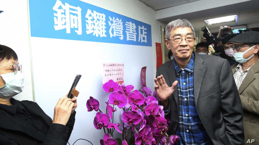 Lam Wing-kee, one of five shareholders and staff at the Causeway Bay Book shop in Hong Kong, waves to the press at his new book…