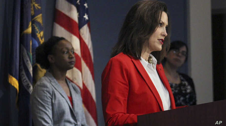 In a pool photo provided by the Michigan Office of the Governor, Michigan Gov. Gretchen Whitmer addresses the state during a…