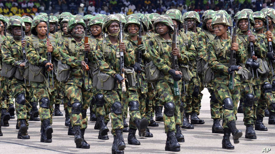 Nigerian soldiers march during 58th anniversary celebrations of Nigerian independence, in Abuja, Nigeria, Monday, Oct. 1, 2018…