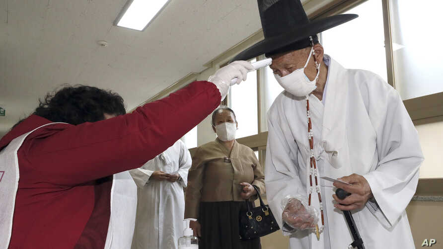 A South Korean Confucian scholar wearing a face mask to help protect against the spread of the new coronavirus has his…