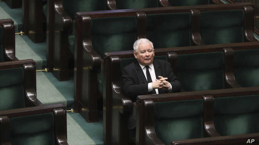 Jaroslaw Kaczynski, leader of the conservative ruling party Law and Justice, takes part in a parliamentary session in Warsaw,…