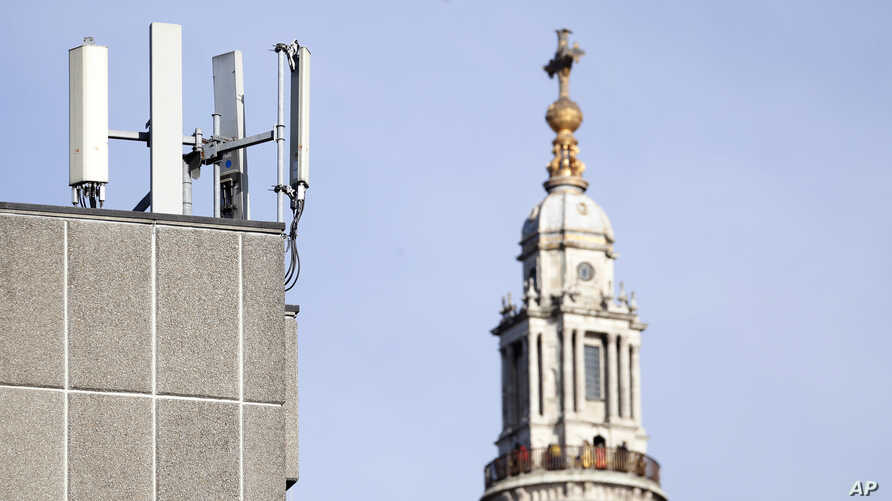 FILE - In this Tuesday, Jan 28, 2020 file photo, mobile network phone masts are visible in front of St Paul's Cathedral in the…