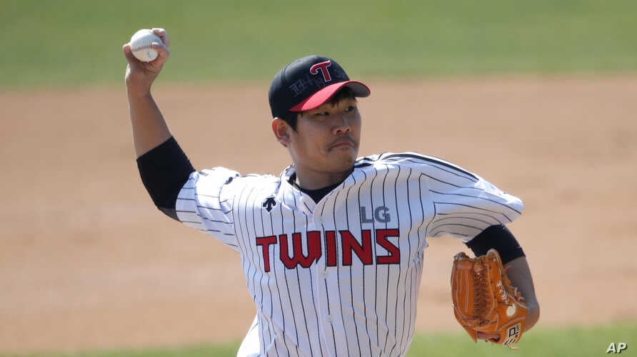 """Letters reading """"Corona 19 Out"""" is seen on the cap of LG Twins baseball team's pitcher Jeong Chan-heon as a part of campaign to…"""