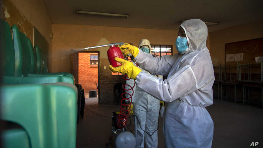 Disinfection team disinfect a classroom at Ivory Park Secondary School east of Johannesburg, South Africa, Thursday, May 28,…