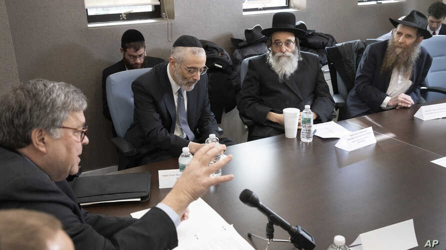 Attorney General William Barr, left, talks with Rabbi Chaim David Zweibel, second left, Rabbi David Niederman, second right,…