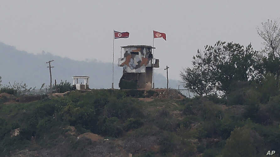 FILE - In this May 3, 2020, file photo, a North Korean flag flutters in the wind at a military guard post in Paju, at the…