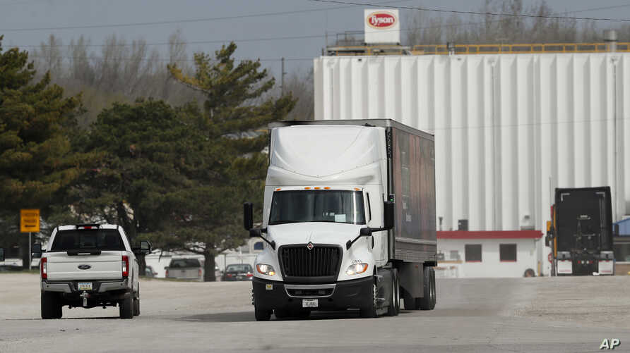 A truck leaves the Tyson Foods pork plant, Wednesday, April 22, 2020, in Perry, Iowa. Daily reports of giant meat processing…
