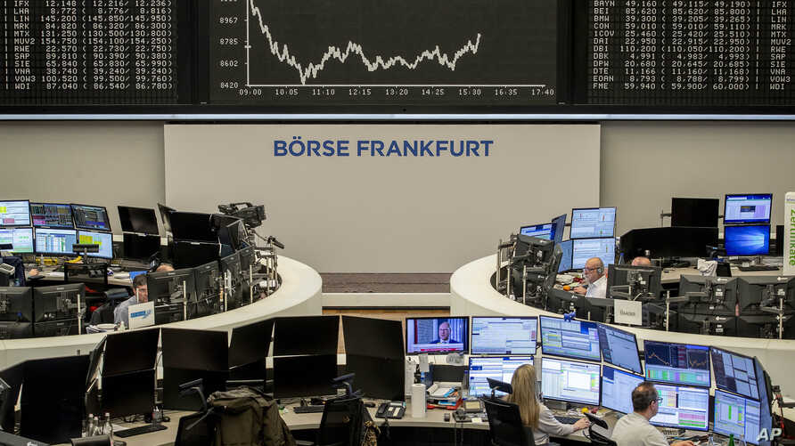 The curve of the German stock index DAX is seen at the stock market in Frankfurt, Germany, Tuesday, March 17, 2020, the day…