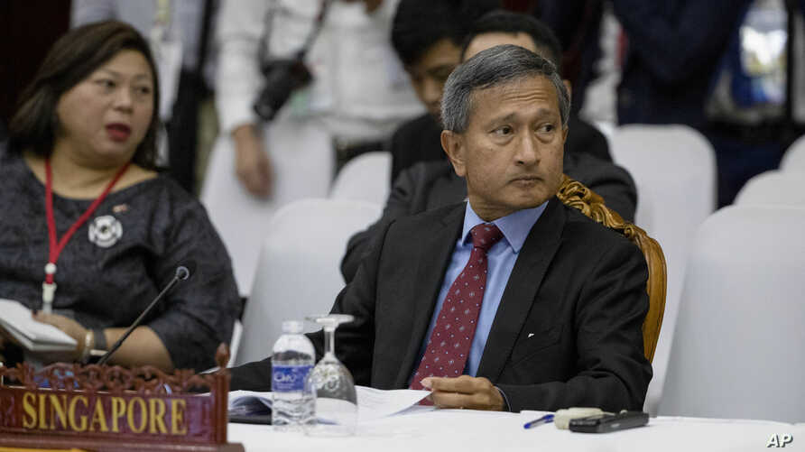 Singapore's Foreign Minister Vivian Balakrishnan, right, attends the Special ASEAN-China Foreign Ministers' meeting on the…