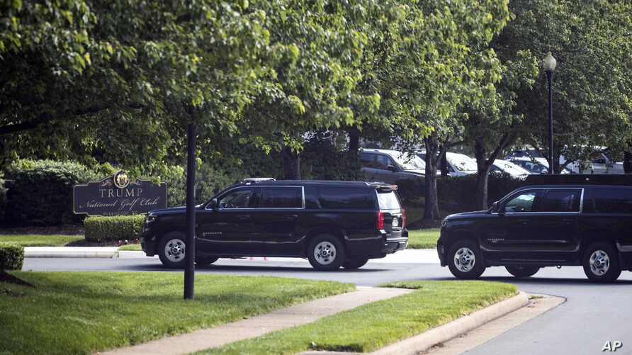 The motorcade for President Donald Trump arrives at Trump National Golf Club, Saturday, May 23, 2020, in Sterling, Va. (AP…