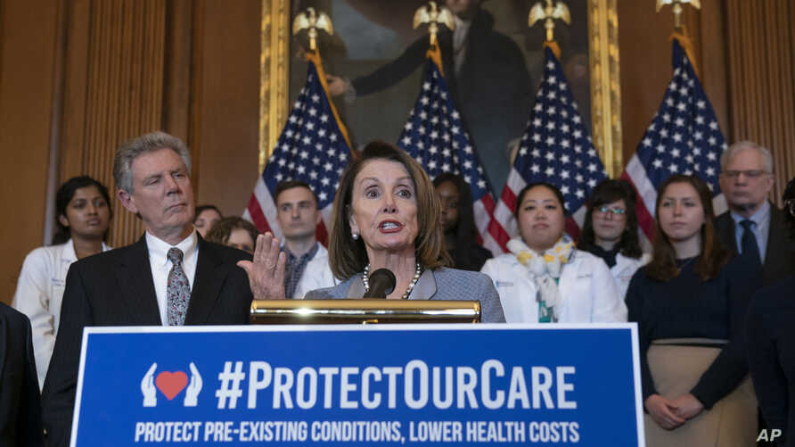 FILE - In this March 26, 2019 file photo, Speaker of the House Nancy Pelosi, D-Calif., joined at left by Energy and Commerce…