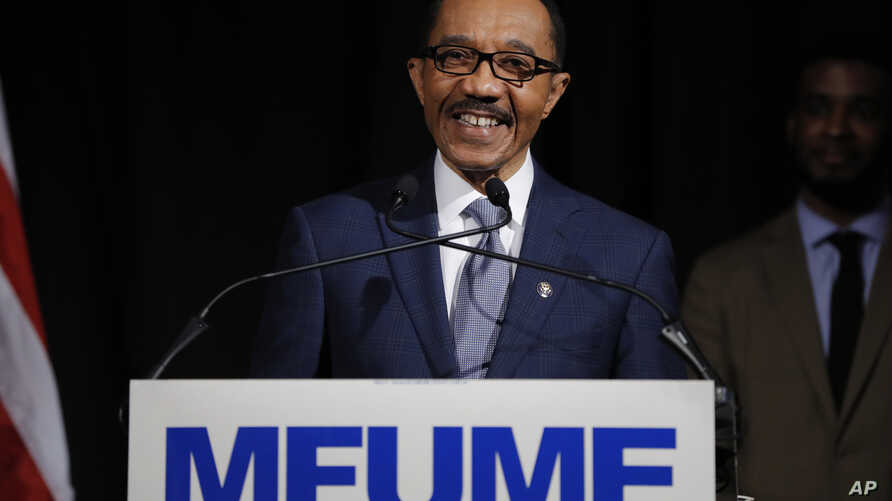 Democrat Kweisi Mfume reacts while speaking to reporters during an election night news conference after he won the 7th…