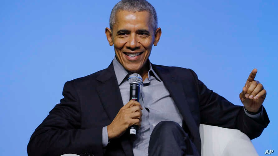 """Former U.S. President Barack Obama gesture as he attends the """"values-based leadership"""" during a plenary session of the…"""
