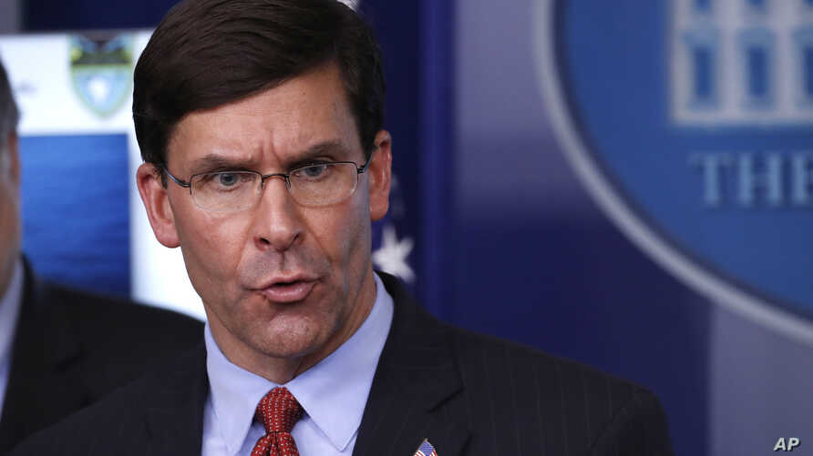 FILE - In this April 1, 2020, file photo, Defense Secretary Mark Esper speaks about the coronavirus in the James Brady Press…