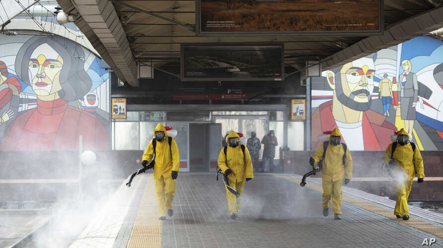 Employees of the Federal State Center for Special Risk Rescue Operations of Russia Emergency Situations disinfect a platform of…