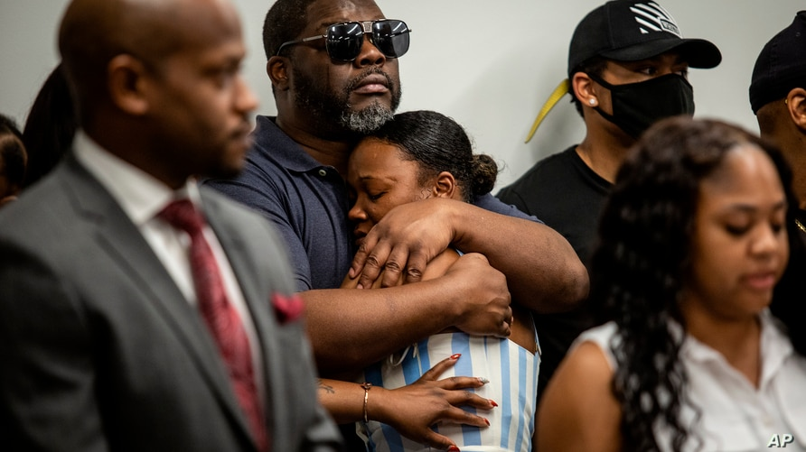 Family members of Rayshard Brooks attend a news conference on Monday, June 15, 2020, in Atlanta. The Brooks family and their…