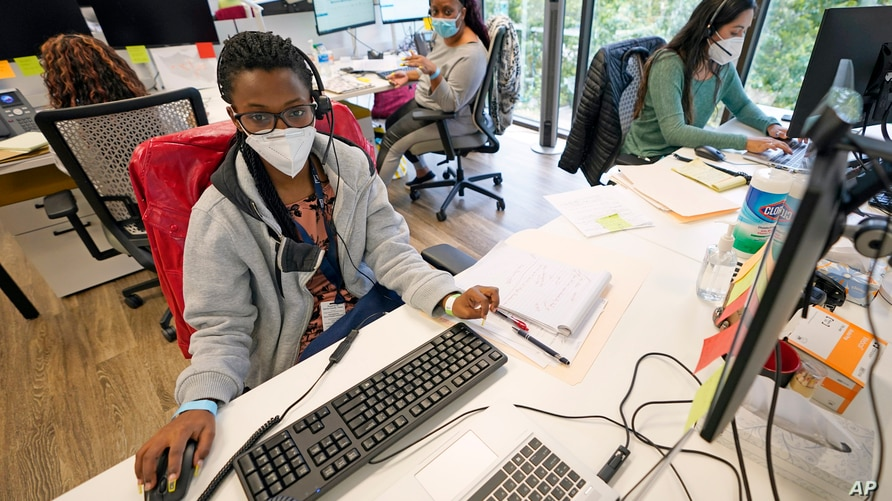 Contact tracers, from left to right, Christella Uwera, Dishell Freeman and Alejandra Camarillo work at Harris County Public…