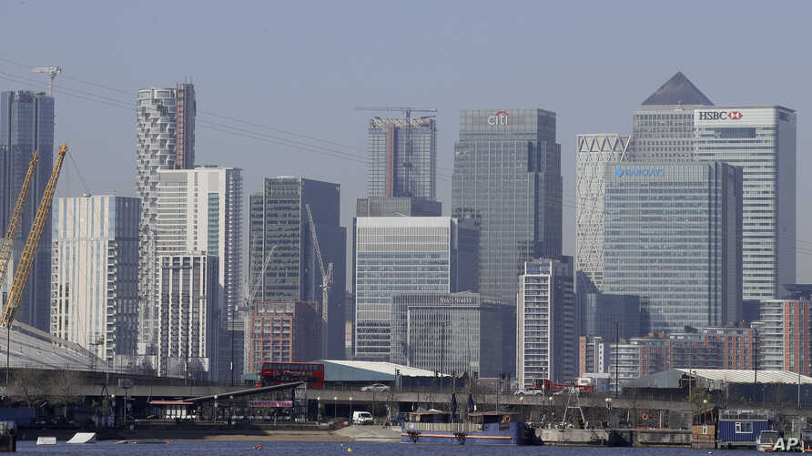 London's financial district in Canary Wharf, London, Wednesday, March 25, 2020. The new coronavirus causes mild or moderate…
