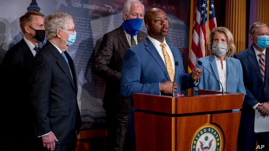 Sen. Tim Scott, R-S.C., center, accompanied by from left, Sen. James Lankford, R-Okla., Senate Majority Leader Mitch McConnell…