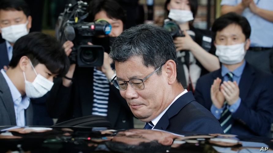 South Korean Unification Minister Kim Yeon-chul gets into a car as he leaves the government complex in Seoul, South Korea,…