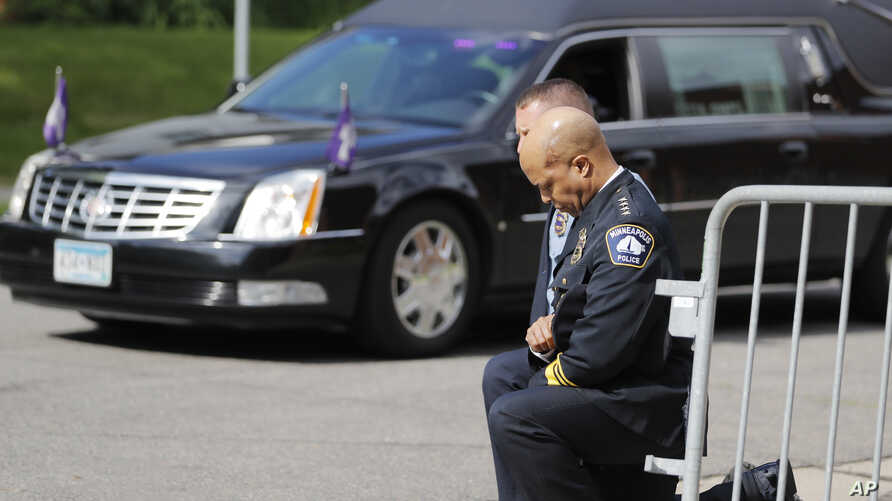 FILE - In this June 4, 2020, file photo, police officers including Minneapolis Police Chief Medaria Arradondo, foreground, take…