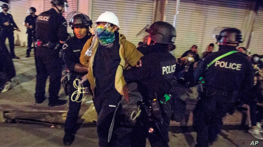 FILE - In this May 31, 2020, file photo, Los Angeles police officers arrest a demonstrator in Los Angeles. The Los Angeles…