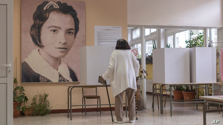 A woman is seen at a polling station during parliamentary election in Belgrade, Serbia, Sunday, June 21, 2020. Serbia's ruling…