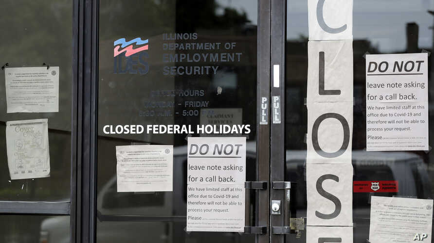 Information signs are posted at the Illinois Department of Employment Security Friday, June 5, 2020, in Chicago. The federal…