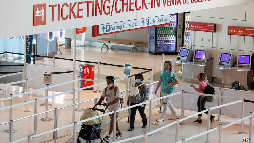 Passengers approach gate security for flights out of Love Field in Dallas, Wednesday, June 24, 2020. New York, Connecticut and…